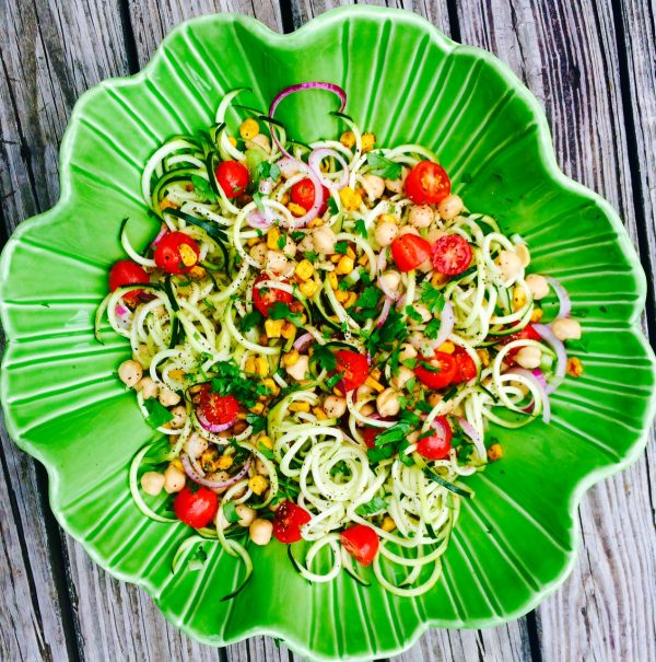 zucchini noodles in green bowl
